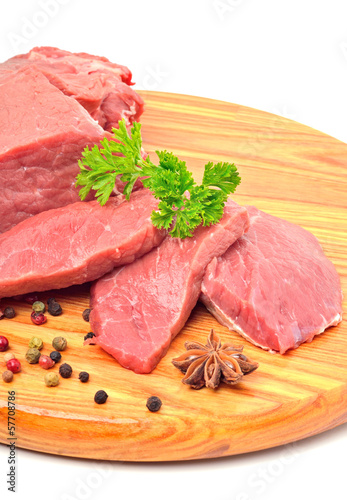 Raw beef and meat slices isolated on white