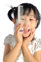 smiling asian little girl with applying make up baby powder on f