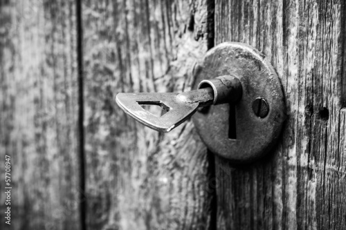 Old key in a rusted door lock