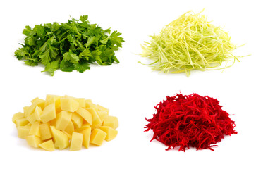 The cut beet, cabbage, potatoes, parsley on white background.