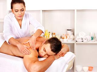 Man getting massage in spa.
