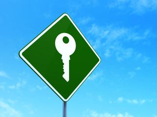Security concept: Key on road sign background