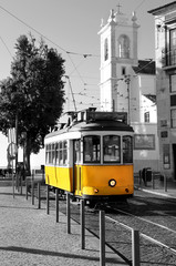 Lisbon old yellow tram over black and white background © Tanouchka