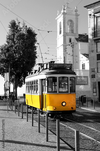 Plagát Lisbon old yellow tram over black and white background