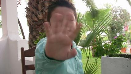 Happy little boy waving