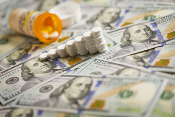Medicine Pills Stacked on Newly Designed One Hundred Dollar Bill