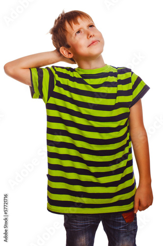 Blond boy in striped green shirt thinks scratching his head hair