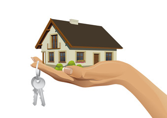 Miniature house building on hand with keys