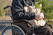Clouse up handicapped man doing his grocery shopping
