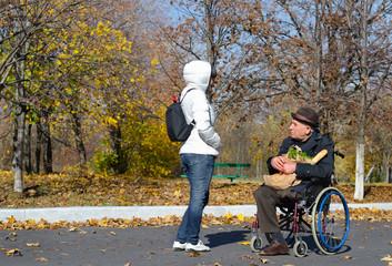 Handicapped senior man in a wheelchair
