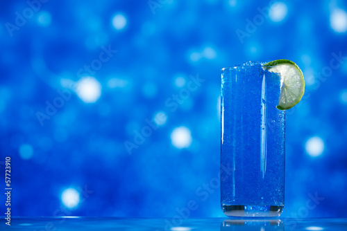 blue slush ice in glass  on glitter star background