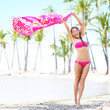 Beach woman waving scarf on happy free vacation