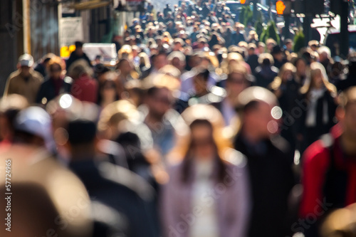 Anonymous crowd walking on a street in New York - 57724965