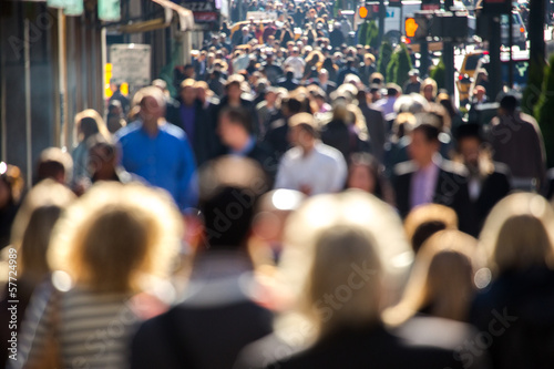 Anonymous crowd walking on a street in New York