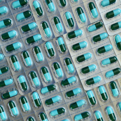 Capsules of oral medications in transparent strips.