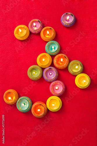 Colorful Diwali Lamps Arranged in Shape of Hindu Sacred Symbol O