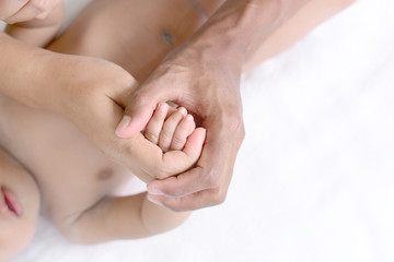 holding a baby hand