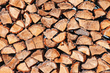 woodpile from dry oak logs poster