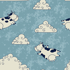 Funny cows flying in the sky with clouds
