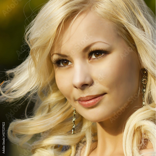 Blonde girl. Portrait of Beautiful Smiling Happy Young Woman