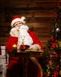 Santa Claus in wooden home interior