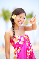 Hawaii beach woman making Hawaiian shaka hand sign