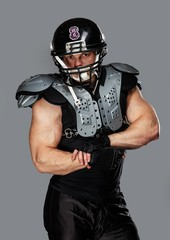 American football player with helmet and armour