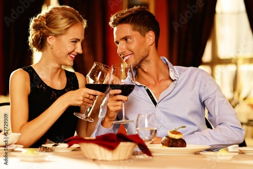 Beautiful young couple in restaurant