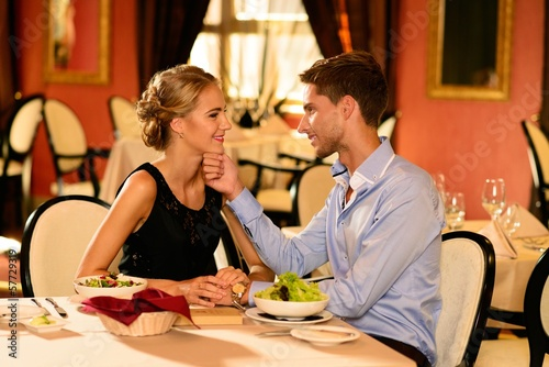 Young beautiful couple in love in a luxury restaurant