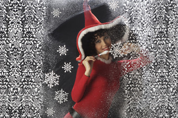 Pretty young woman in Santa Claus clothes