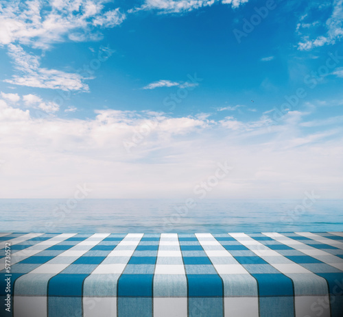 Fotobehang Picknick Tablecloth on Ocean