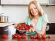 woman eating strawberries