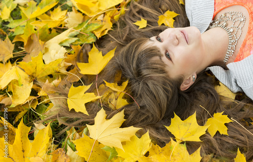 Beautiful girl with long hair in autumn park