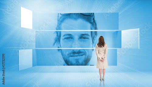 Rear view of businesswoman looking at smiling man