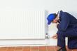 Handyman repairing a radiator