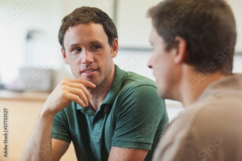 Two handsome mature students having a conversation