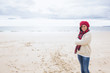 Portrait of a pretty woman in stylish warm wear at beach