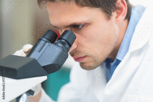 Scientific researcher using microscope in the laboratory