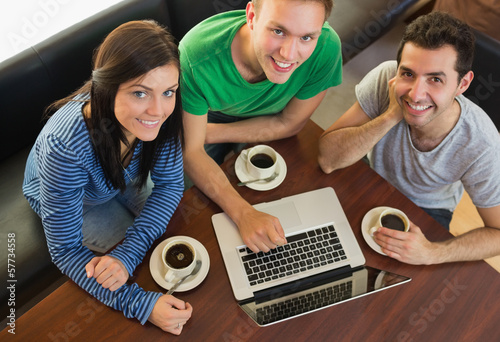 Students using laptop while having coffee at  coffee shop