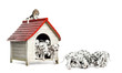 Herd of Dalmatian puppies playing and eating around a kennel