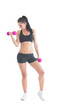 Beautiful sporty woman training with dumbbells