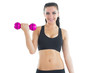Joyful active woman training with a dumbbell smiling at camera