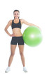 Attractive slender woman posing holding a green exercise ball