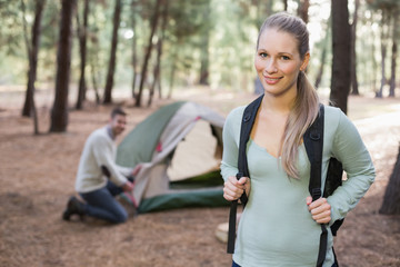 Young couple with tent in the wilderness