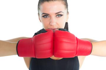 Gorgeous sporty woman posing wearing boxing gloves
