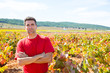 Harvester winemaker farmer proud of his vineyard