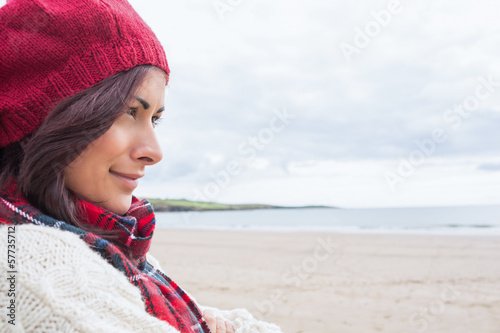 Woman in knitted hat and pullover at beach