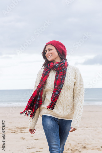 Woman in stylish warm clothing at beach