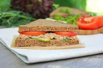 Sandwich with rye bread, tomatoes, cucumber
