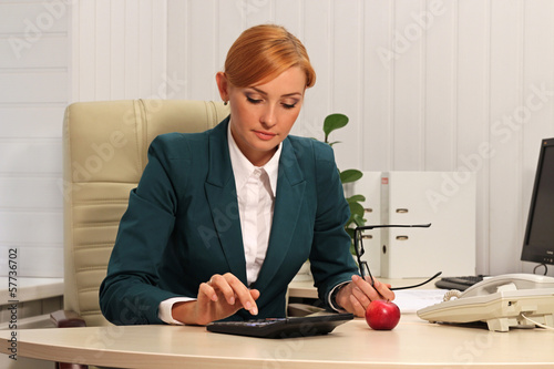 Businesswoman calculating